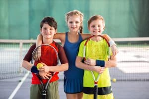 kids having fun on tennis court